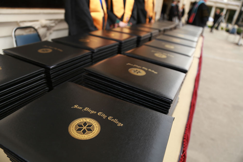 City College diplomas lined up at graduation