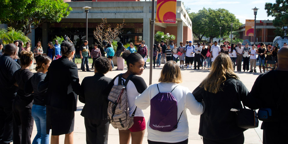 Students come together for a moment of silence at City College
