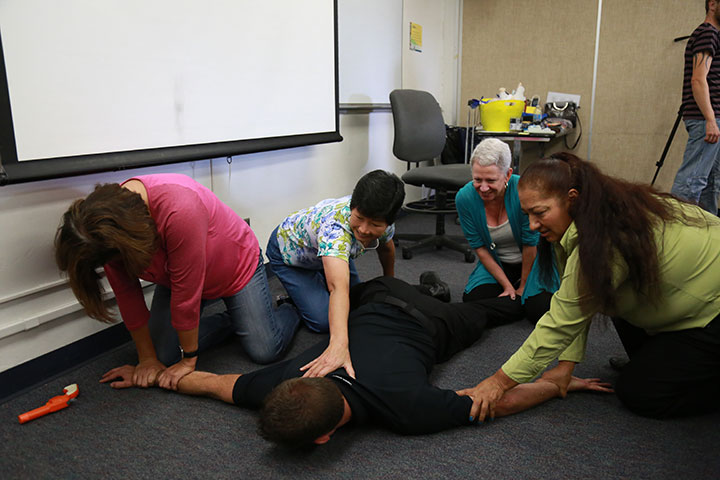 Faculty and staff at San Diego City College participate in training on how to respond to an active-shooter situation.