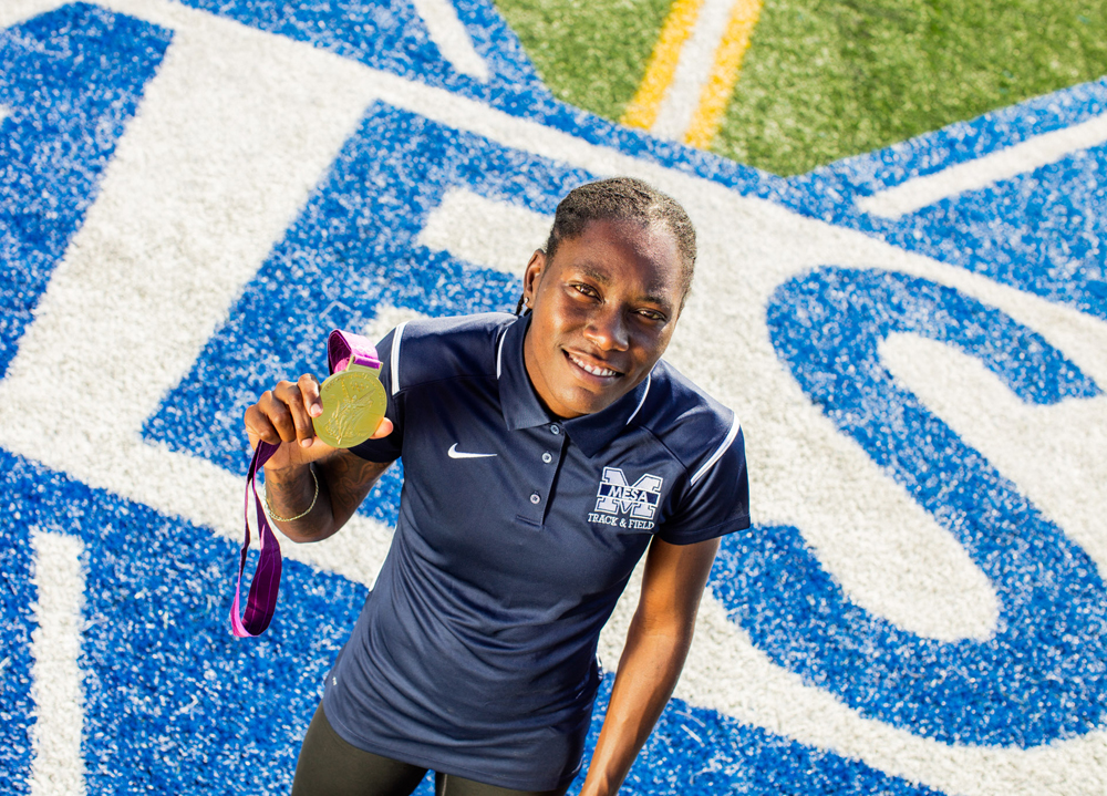 Brittney Reese at the Mesa College track with her London 2012 Olympic Gold medal