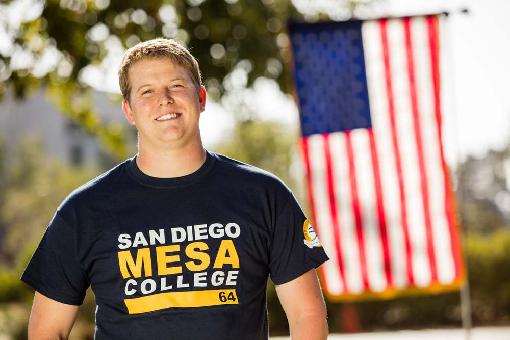 Mesa College student Calvin Dixon posed in front of an American Flag