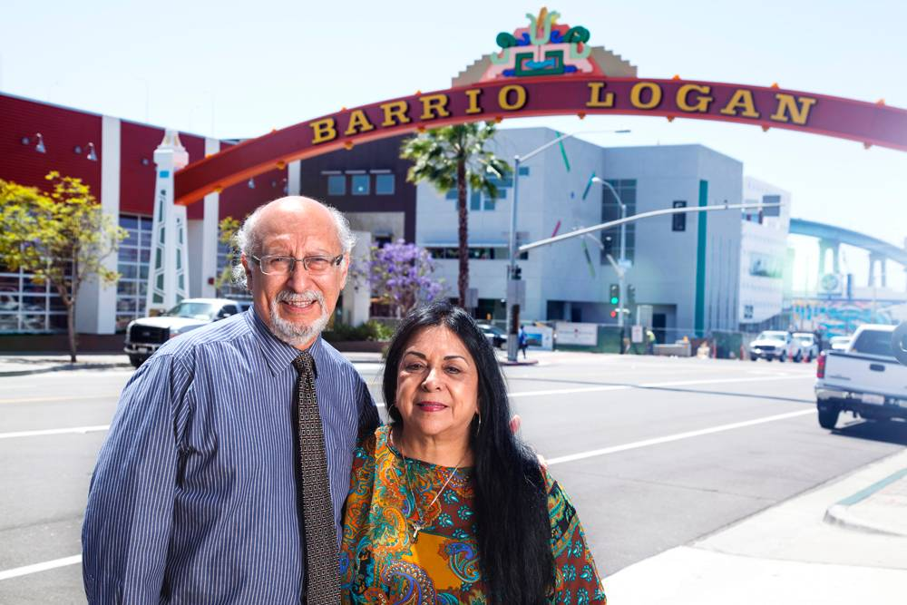 Architect Joseph Martinez and Barrio Station Executive Director Rachael Ortiz at the Barroio Logan gateway with the Cesar E. Chavez Continuing Education campus in the background.