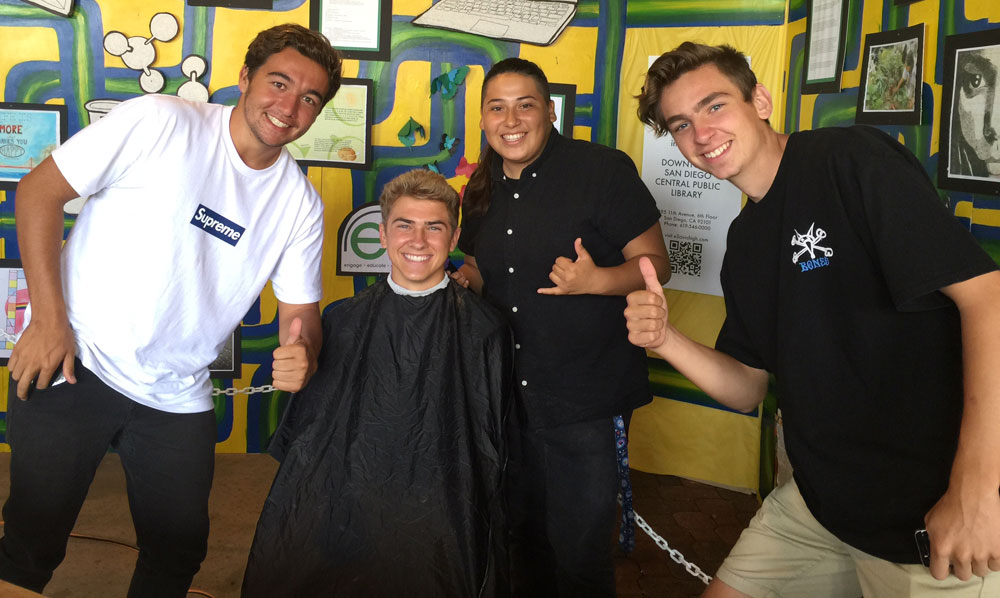 Cosmetology students show of the new haircut of a San Diego County Fair patron