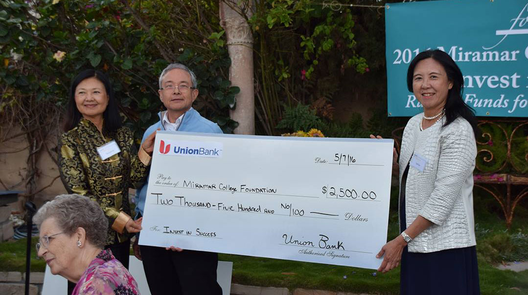 A giant check for $2,500 is donated to the Miramar College Foundation from Union Bank