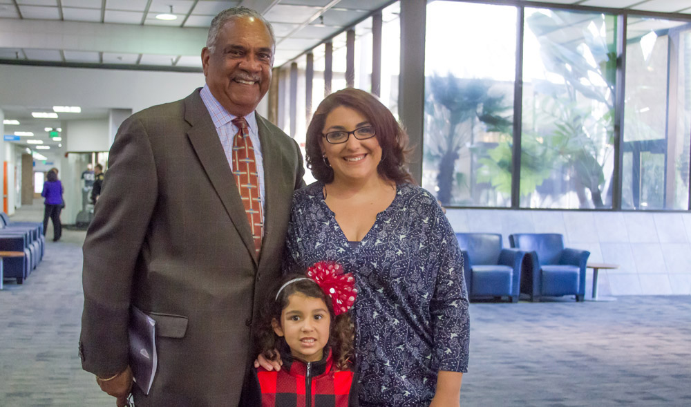 Angel Woods, her daughter and Rescue Mission CEO Herb Johnson