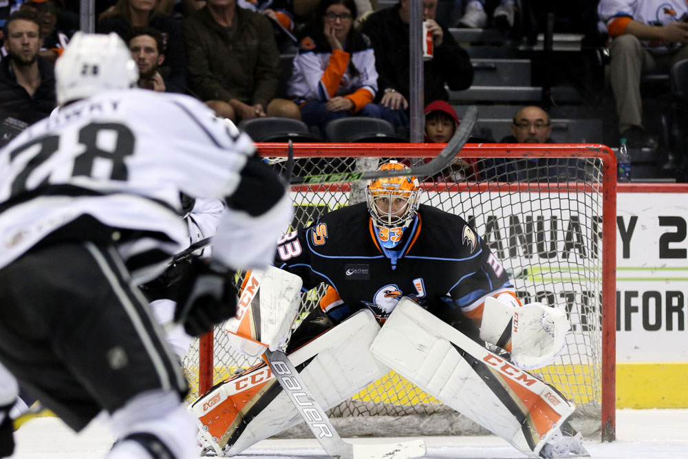 The San Diego Gulls goalie guards the front of the goal
