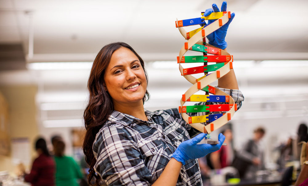 A student holding a model of a molecule