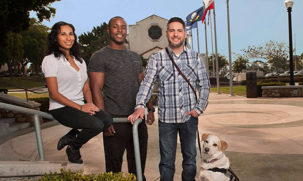 Karina Miranda, Francis Rowe and Randall Dexter with his service dog, Captain.
