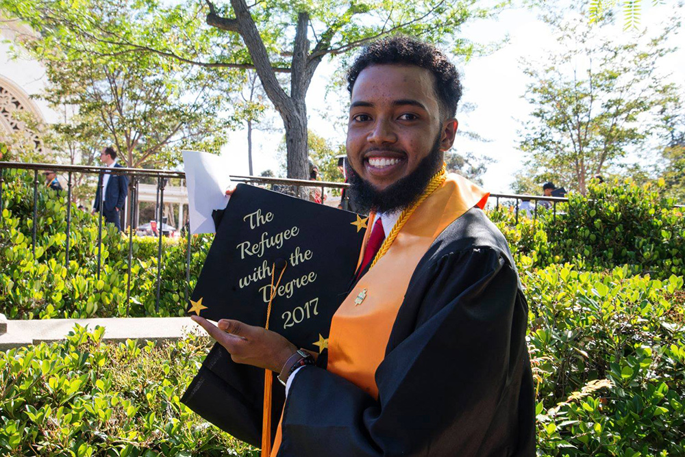 City College graduation shows off his graduation cap