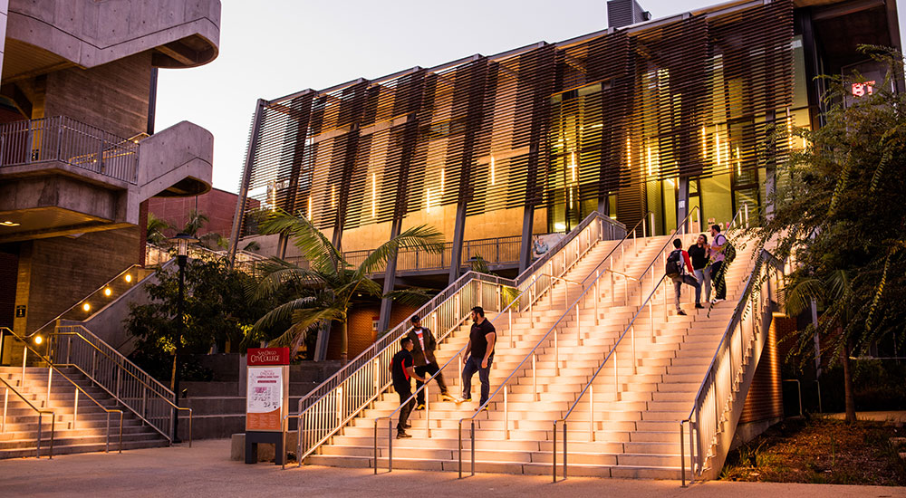Stairs are lit up at night at City College.