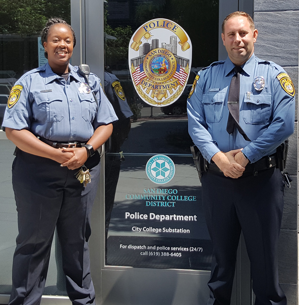 Two campus service officers wearing the new blue uniforms