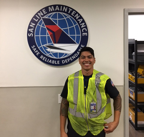 A Miramar College aircraft maintenance student