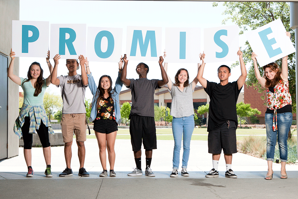 Students at Miramar college hold up letters spelling Promise