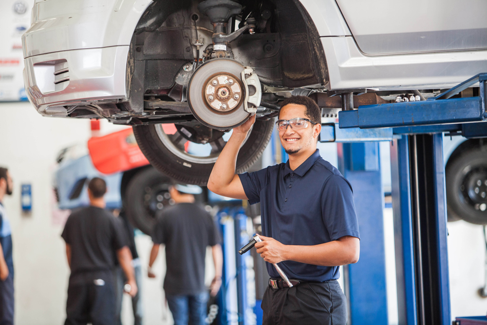 An auto tech student works on a car