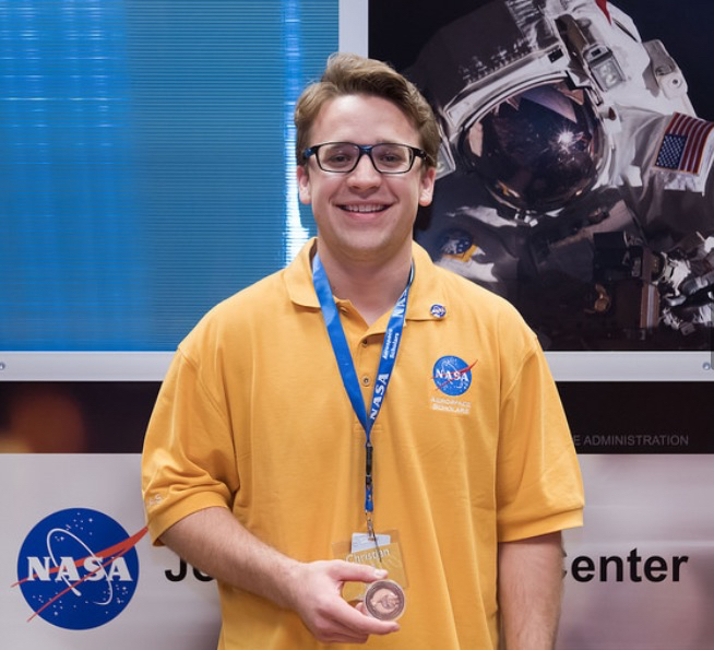 Christian Pratt shows his Nasa medal