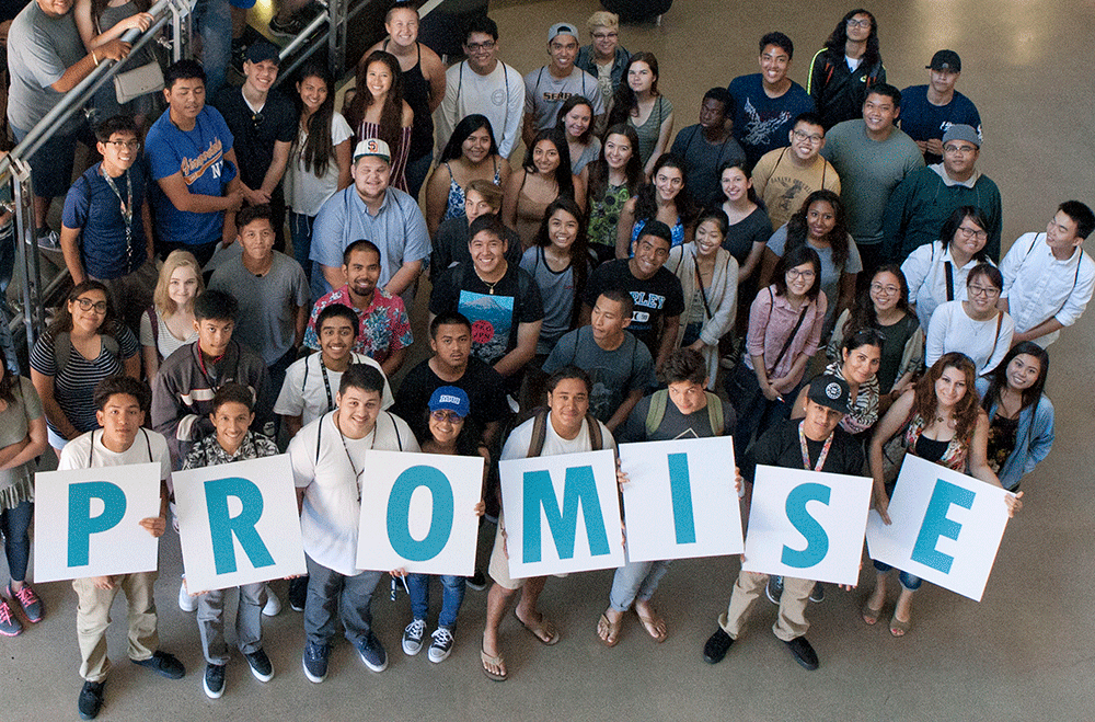 Promise students in a group holding up letters spelling promise