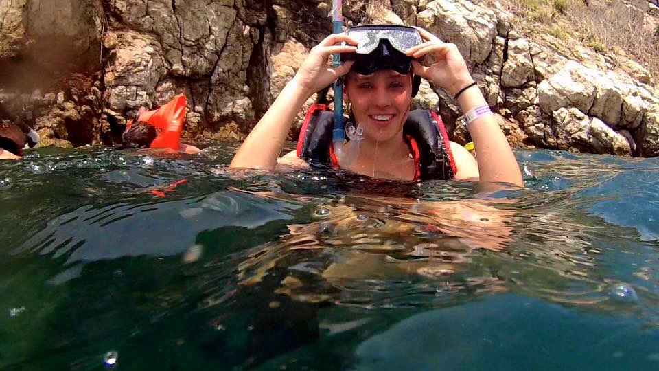 A student snorkeling during a study abroad trip