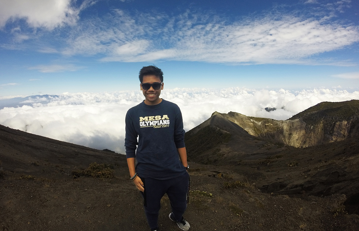 Mesa student Harley Sobreo on a mountain top in Costa Rica