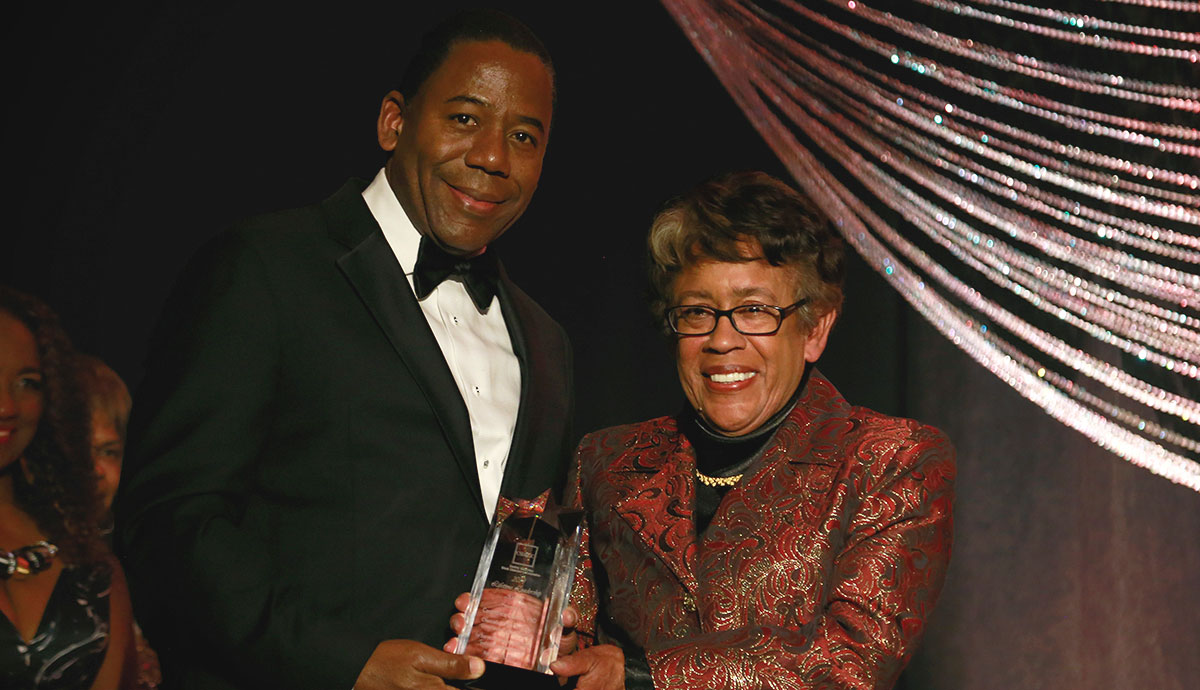 SDCCD Chancellor Constance M. Carroll accepts the Lifetime Leadership Award from J. Bruce Mayberry at the Central San Diego Black Chamber of Commerce's ninth annual gala