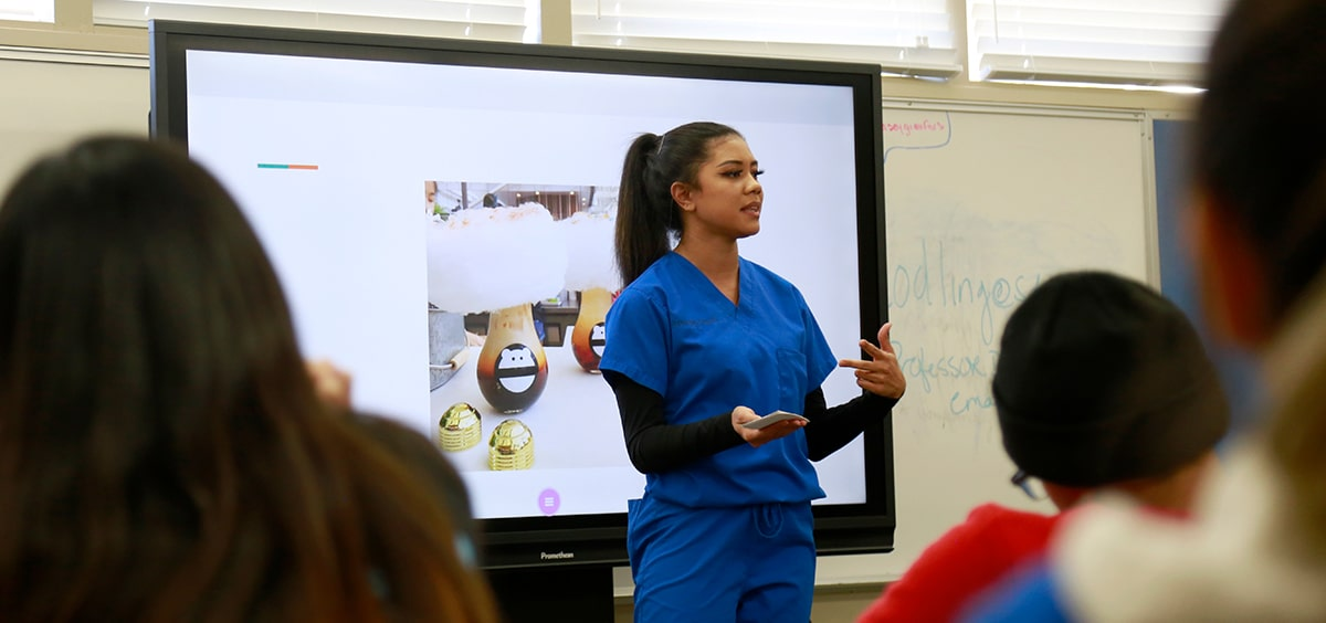 A high school student gives a presentation in class