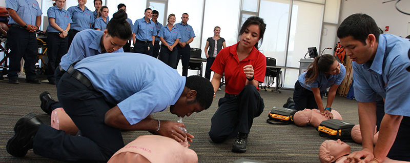 practicing cpr in an emt class