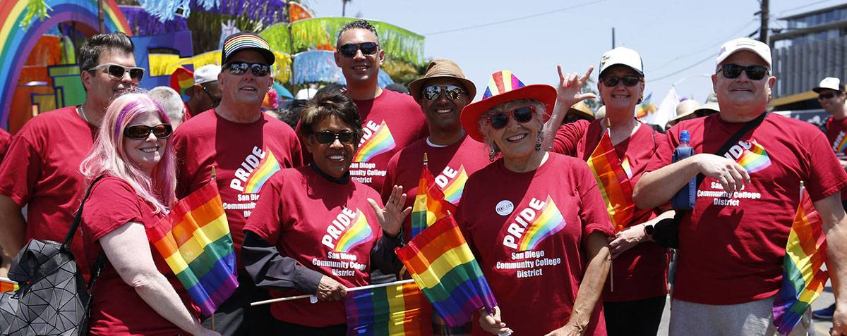The chancellor, presidents, and the board of trustees celebrate at the annual pride parade