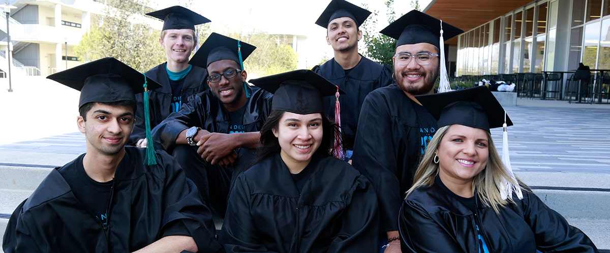 Seven promise students in their caps and gowns