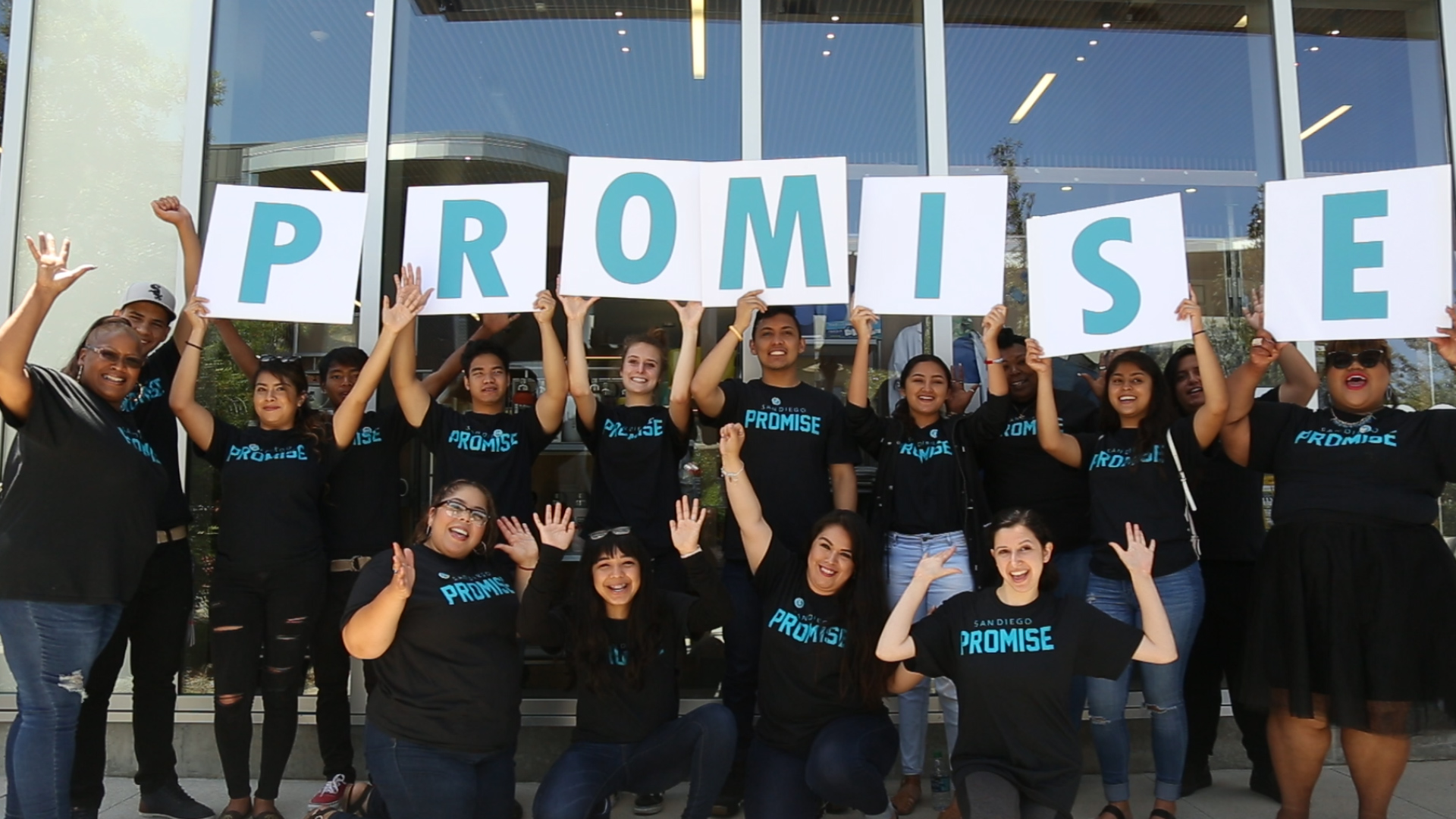 Students hold up letters spelling Promise