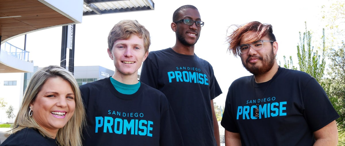 Four students wearing promise t-shirts