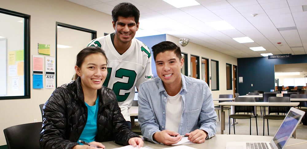 Three students studying at mesa college