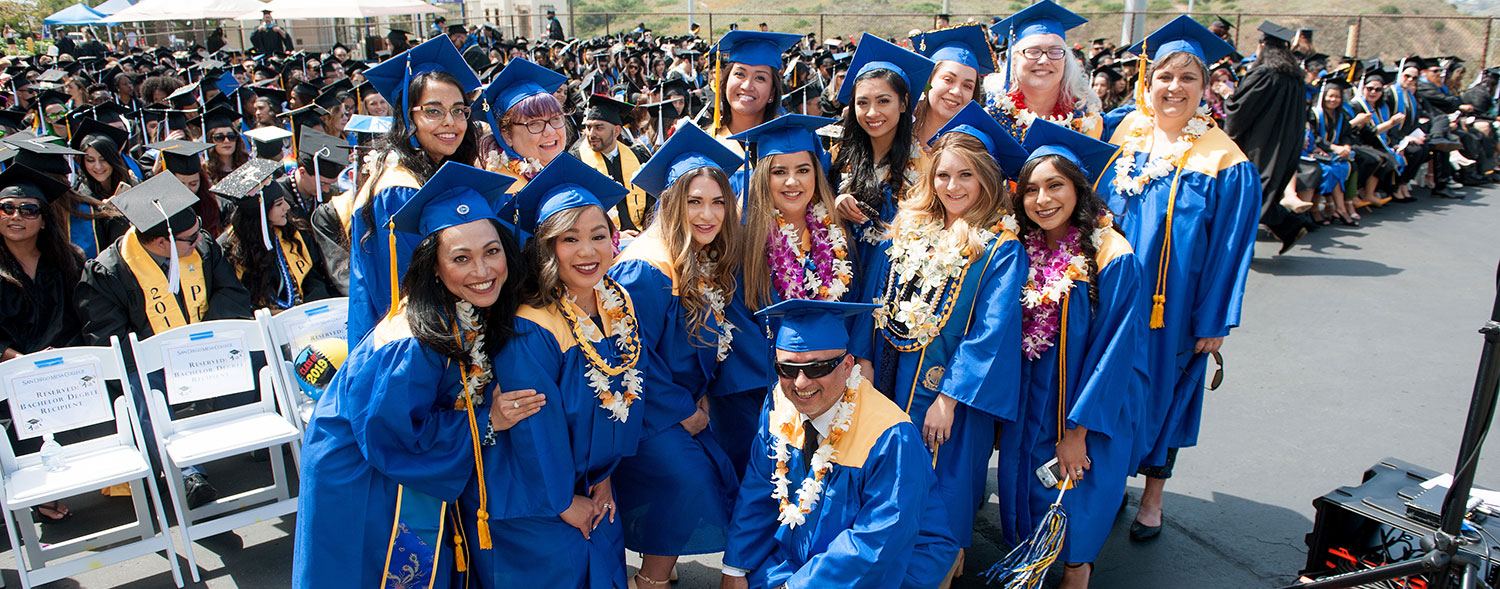Students from Mesa College's Health Information Management baccalaureate program proudly pose during their commencement ceremony.