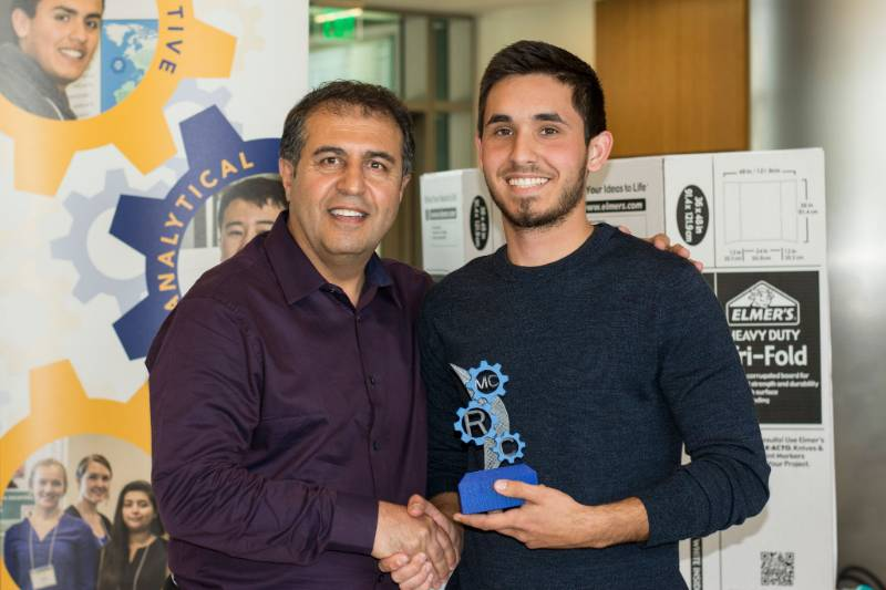 A student is given an award during the Mesa College Research Conference (MCRC), an event that showcases research-based presentations.