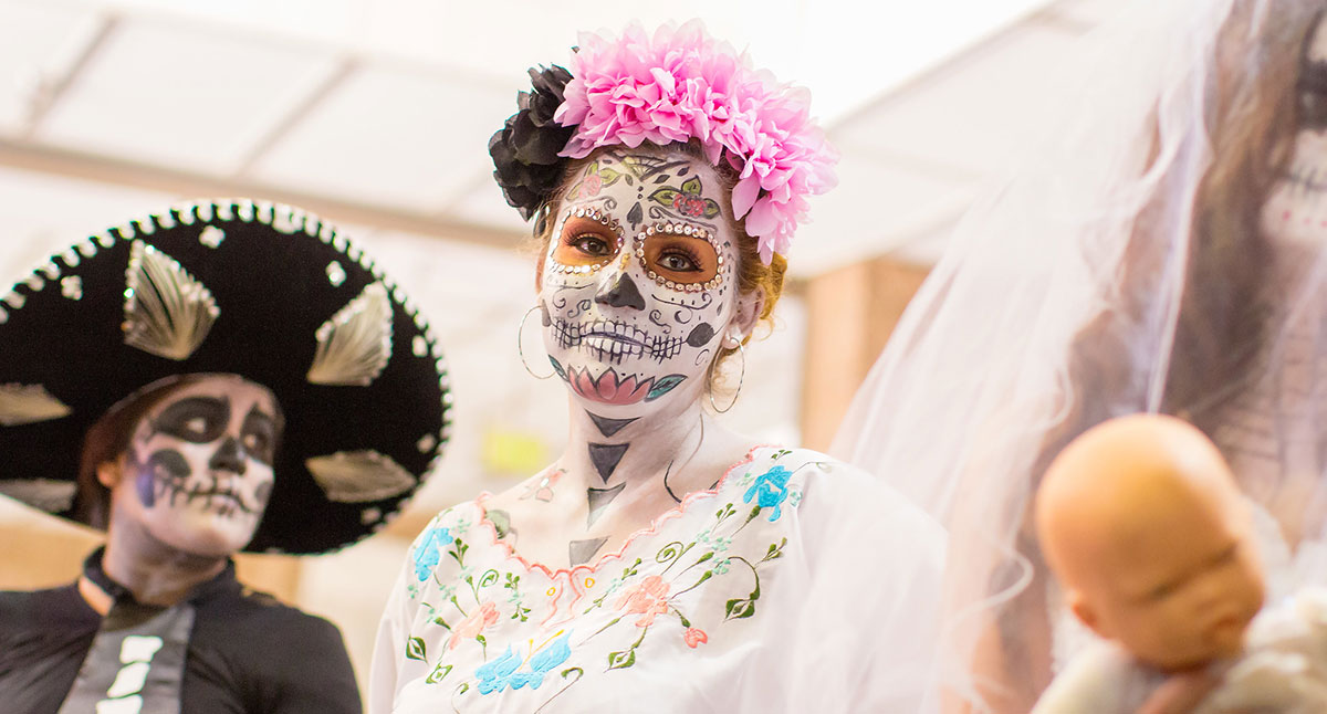 A woman with her face painted for Dia de los Muertos