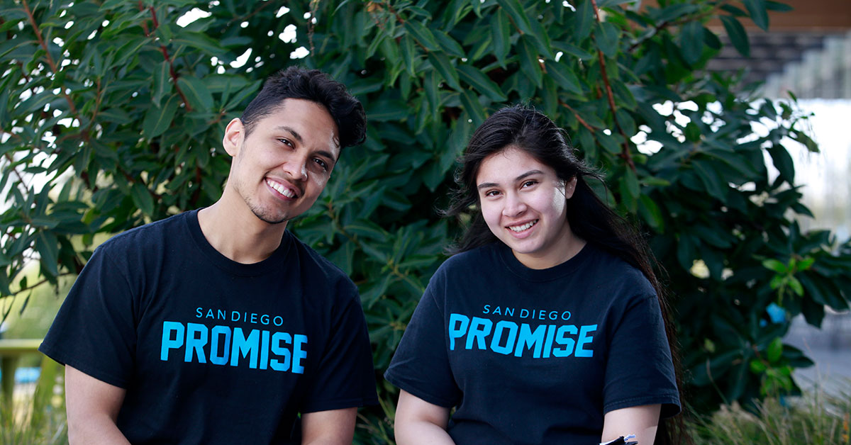 Two students wearing Promise t-shirts