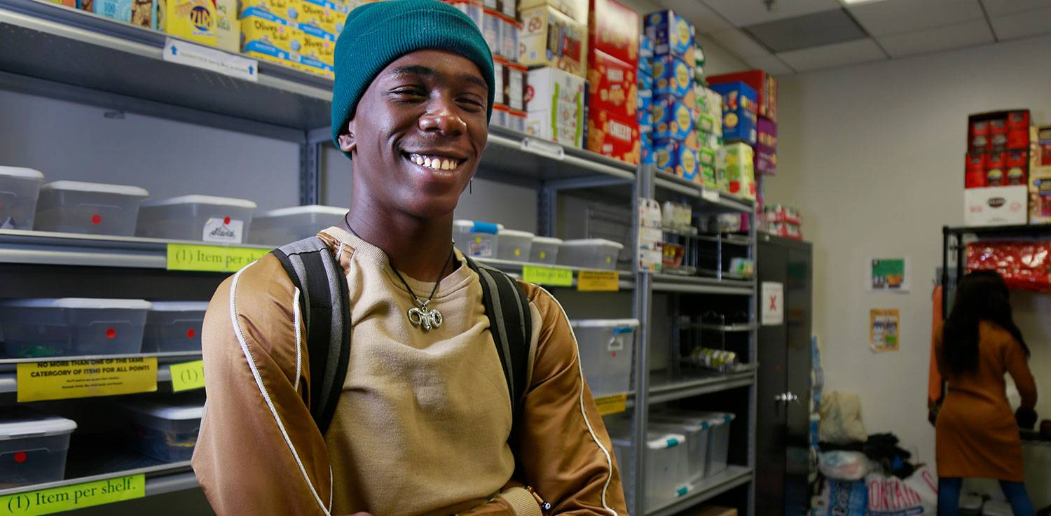 Student Rickanian Williams in the Mesa Food Pantry