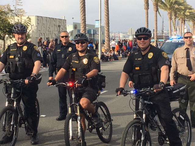 Three SDCCD police officers on bicycles
