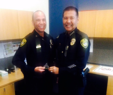 Chief hands over a patch to an officer